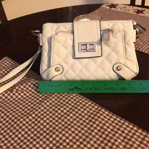 Cute quilted wristlet. Off white